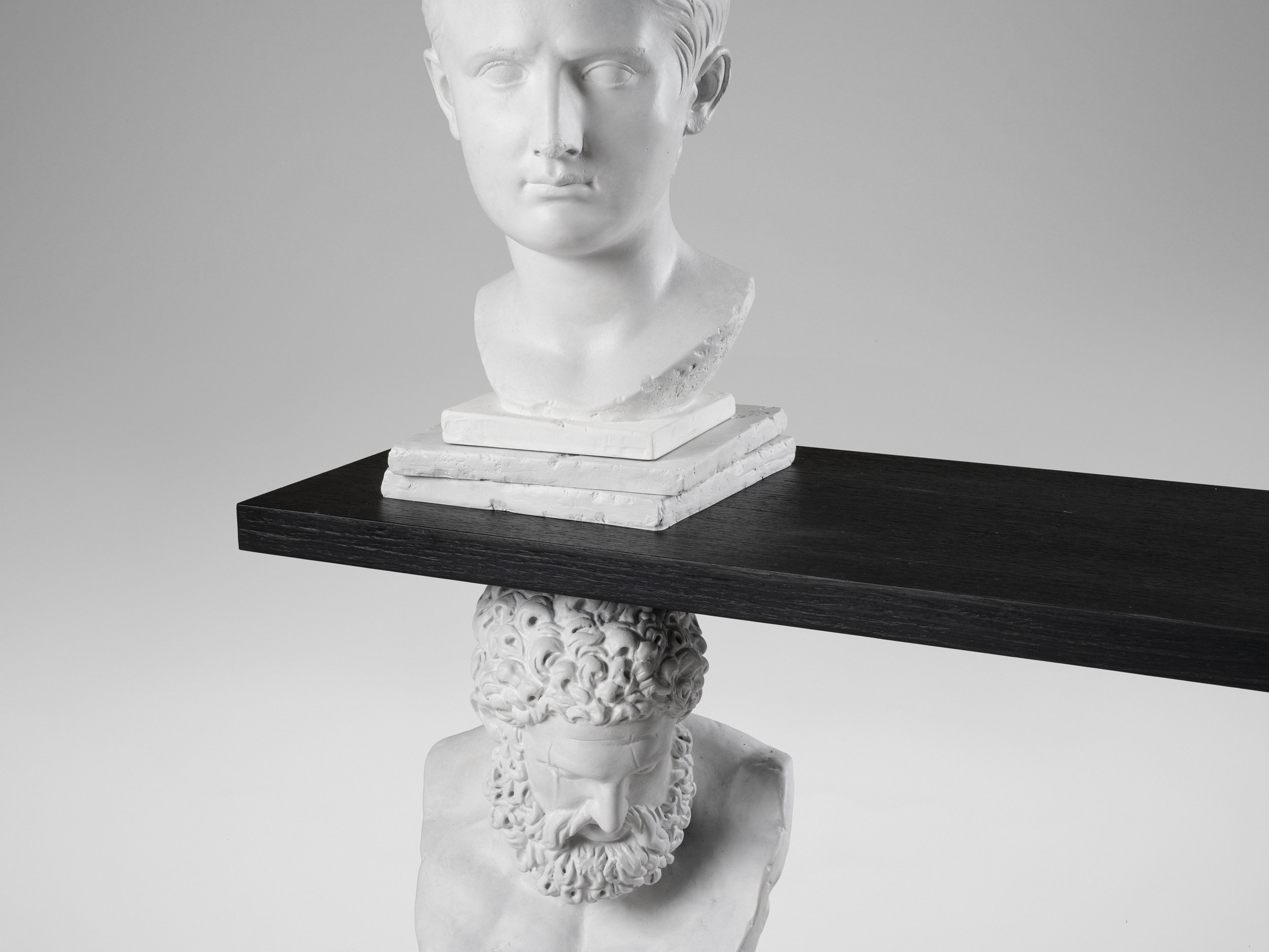 """This work is a part of a new exhibition in David Gill Gallery based at London.The exhibition will showcase Greek and Roman masterpieces from renowned museums, 3D scanned, digitally manipulated and re-cast in marble as functional sculptures.  """"I use technology to """"steal"""" classical sculptures I have revered since childhood. Claim their shapes as raw material to build my own new works. It's an act of gluttony and lust to appropriate that which belongs to the sacred world of the arts and use it freely in an exploration of its boundaries within the realm of the functional and the mundane. """"– Sebastian Errazuriz.  Following his recent 'Antiquity' (2014) in which Errazuriz transformed the historic icon into a functioning bookshelf, this new series of limited-edition works pay homage to ancient sculpture while blurring the boundary between art and design. For the Bookcase 'Antiquity Shelves Nike' (2017), a replica of the headless Nike (Winged Goddess) is enveloped in a wooden 'scaffold' that functions as shelving. Errazuriz's experimentation with innovative processes in design and art include augmented and virtual reality.  Parallel to the investigation between art and design, Errazuriz dives headstrong into the question of breakage as a vital aesthetic resource, whether it is historical and accidental, or artistic and purposeful.""""Many of the sculptures we have learned to love and revere are broken, fragmented.Would they be as mysterious and fascinating to us if we could see them in their pristine original appearance?""""  Errazuriz confronts various subjects and intellectual questions in this series of works, maintaining the precarious balance of tension and release, reverence and sacrilege, delicacy and brutality."""
