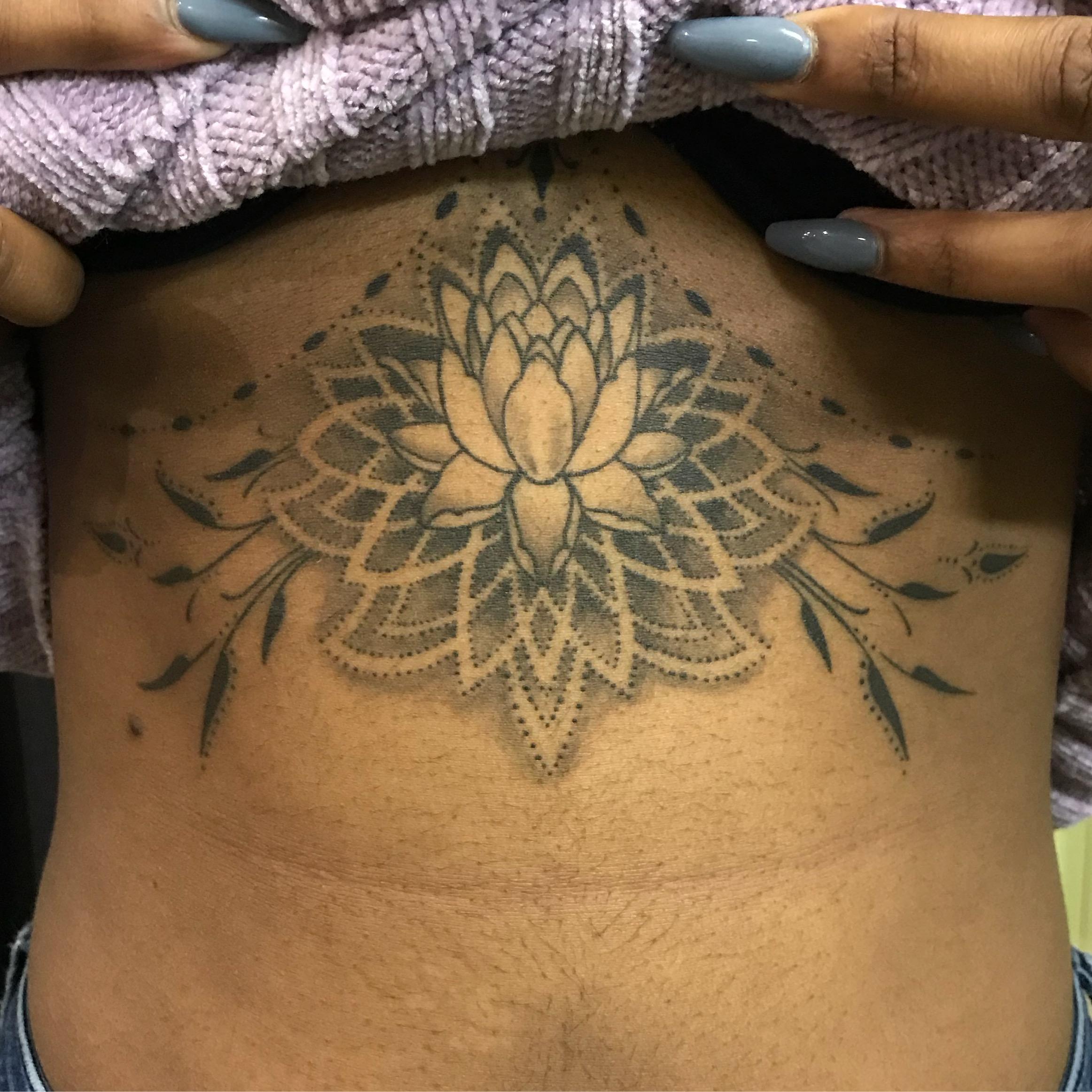 bg Justin Turkus Philadelphia fine line lettering best tattoo Artist lotus geometric sternum healed fullsize.jpg