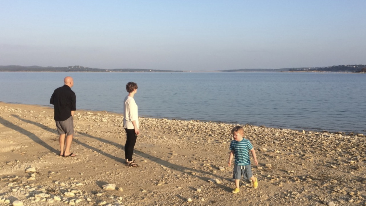 Skipping Rocks at my beach with mom and dad
