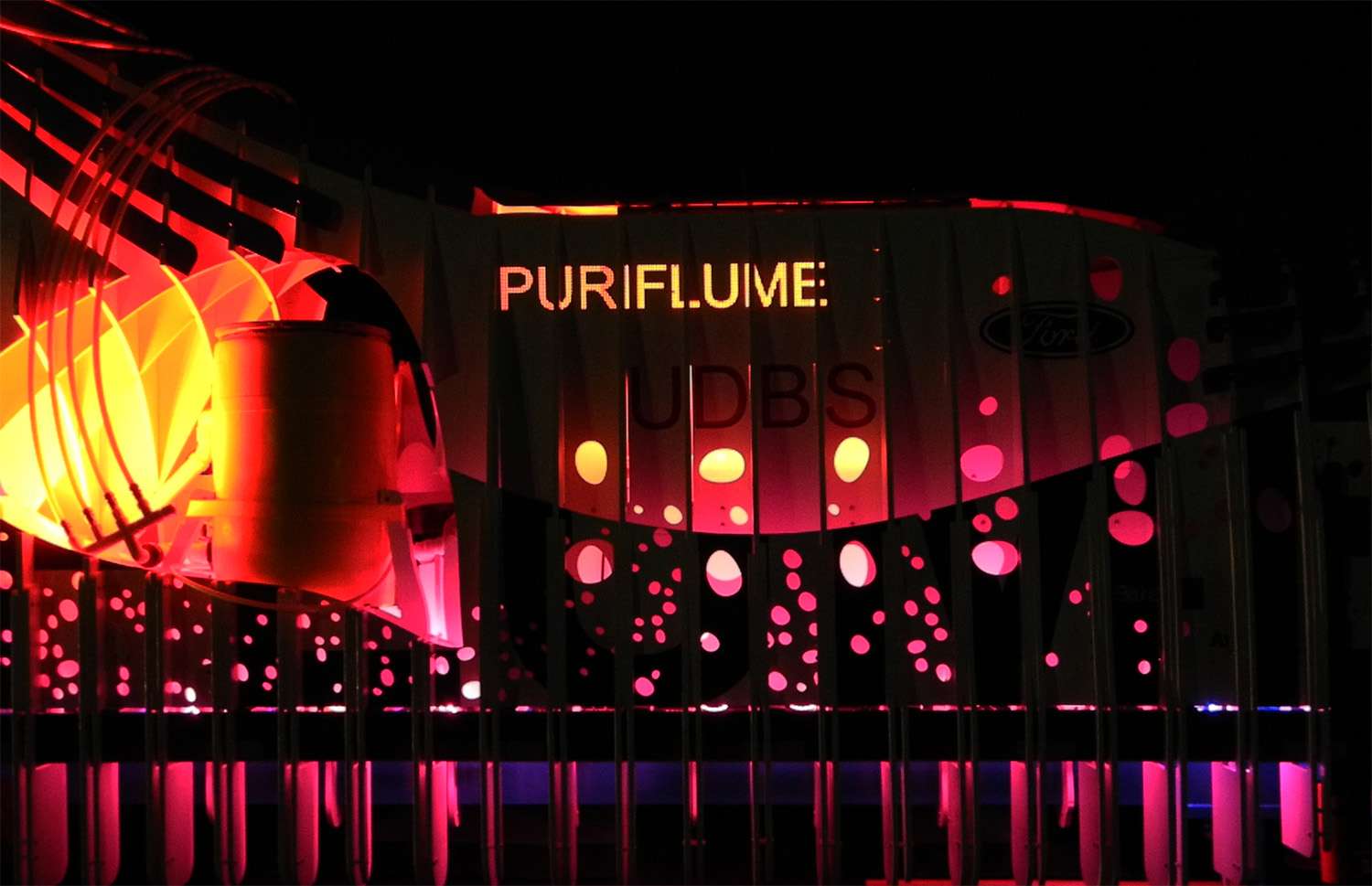 Lighting on educational side with PURIFLUME signage.