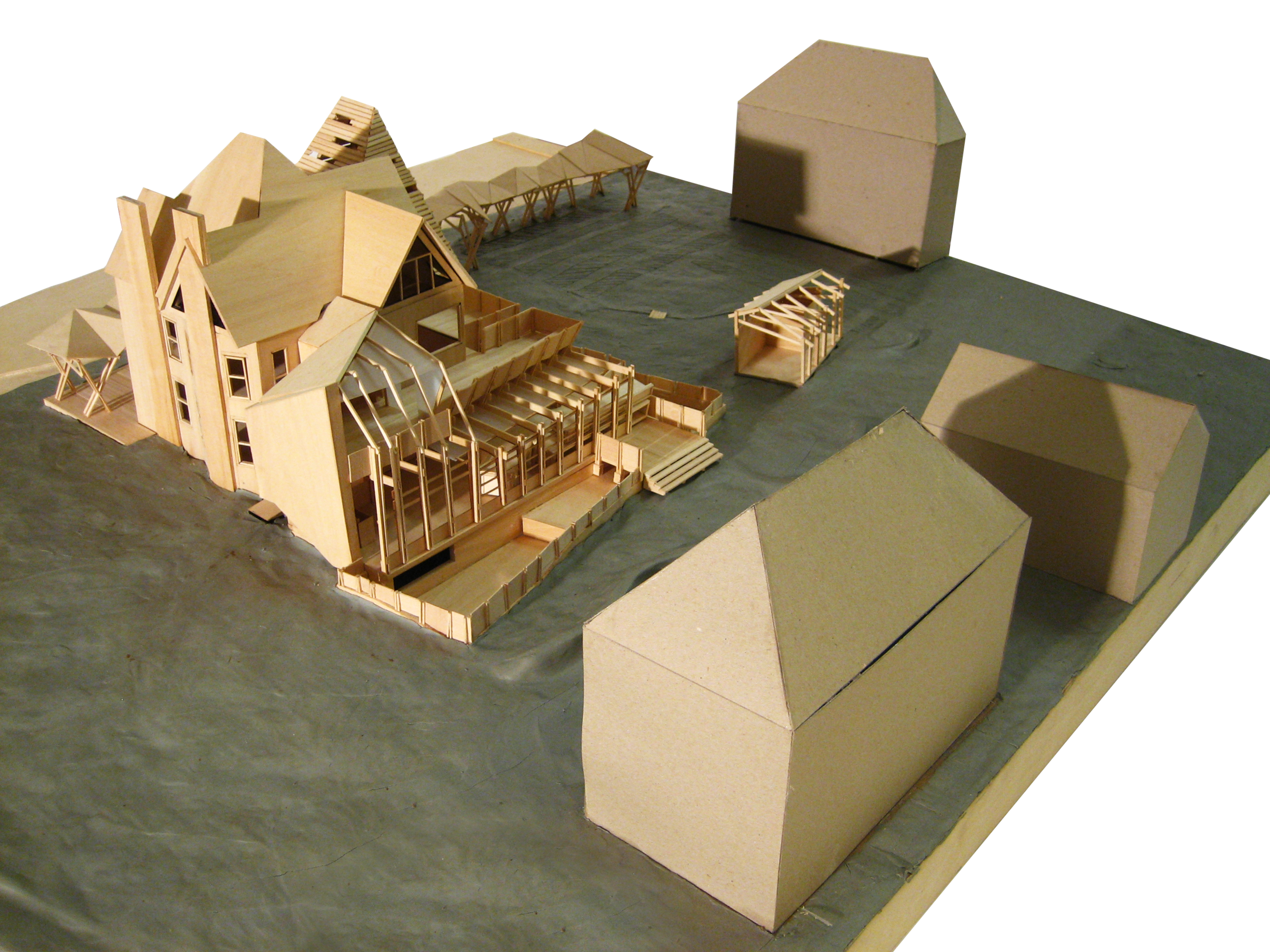 Scale model of greenhouses and community porch.