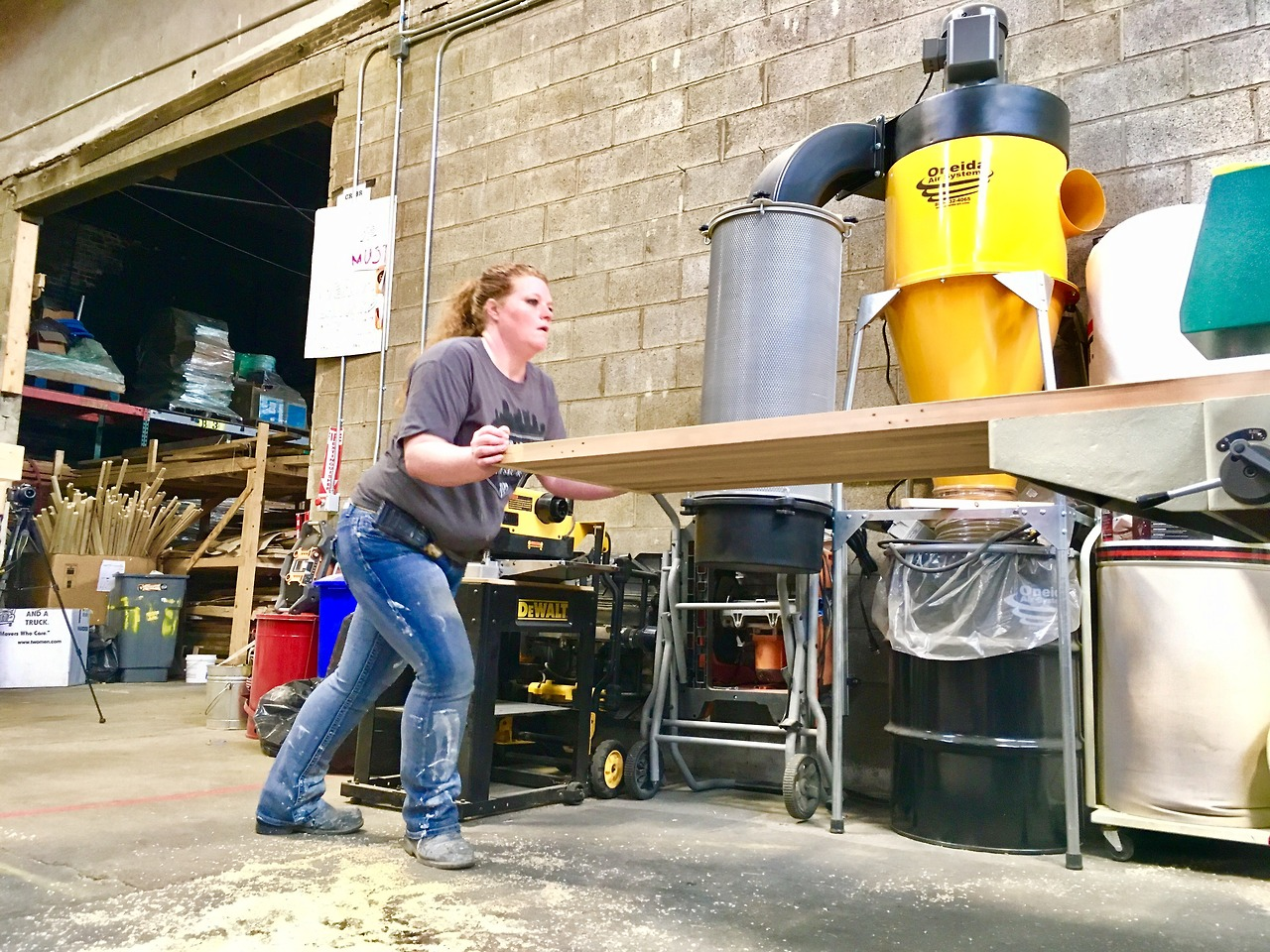 Courtney, the PROJECT RE_ Entrepreneur-In-Training (EIT) for FIRST COURSE, literally builds her business as she planes down the reclaimed cedar doors that will form the shells of the mobile cafe carts.