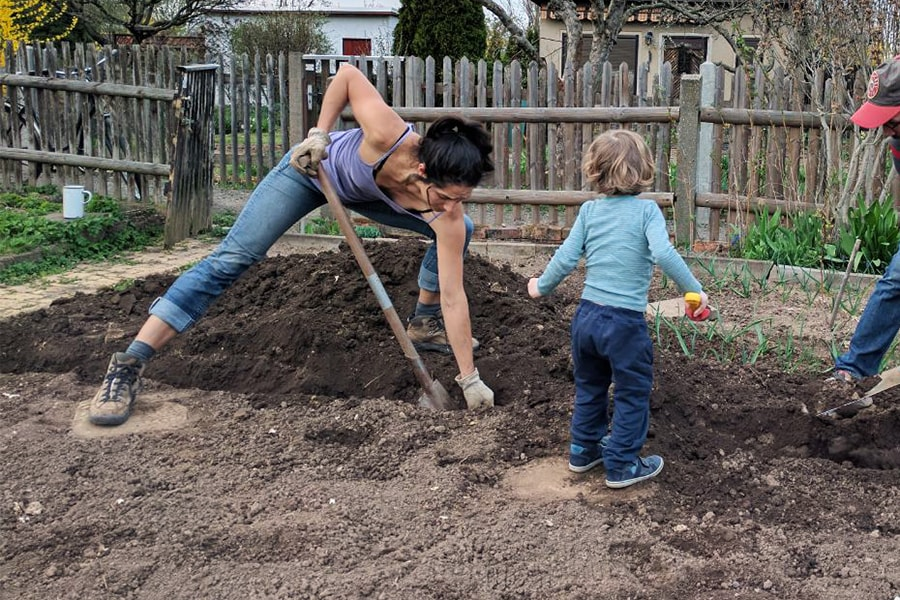 2016 Delbert Highlands Travel Fellowship award winner Louisa Jáuregui gets her hands dirty in her Leipzig kleingarten.