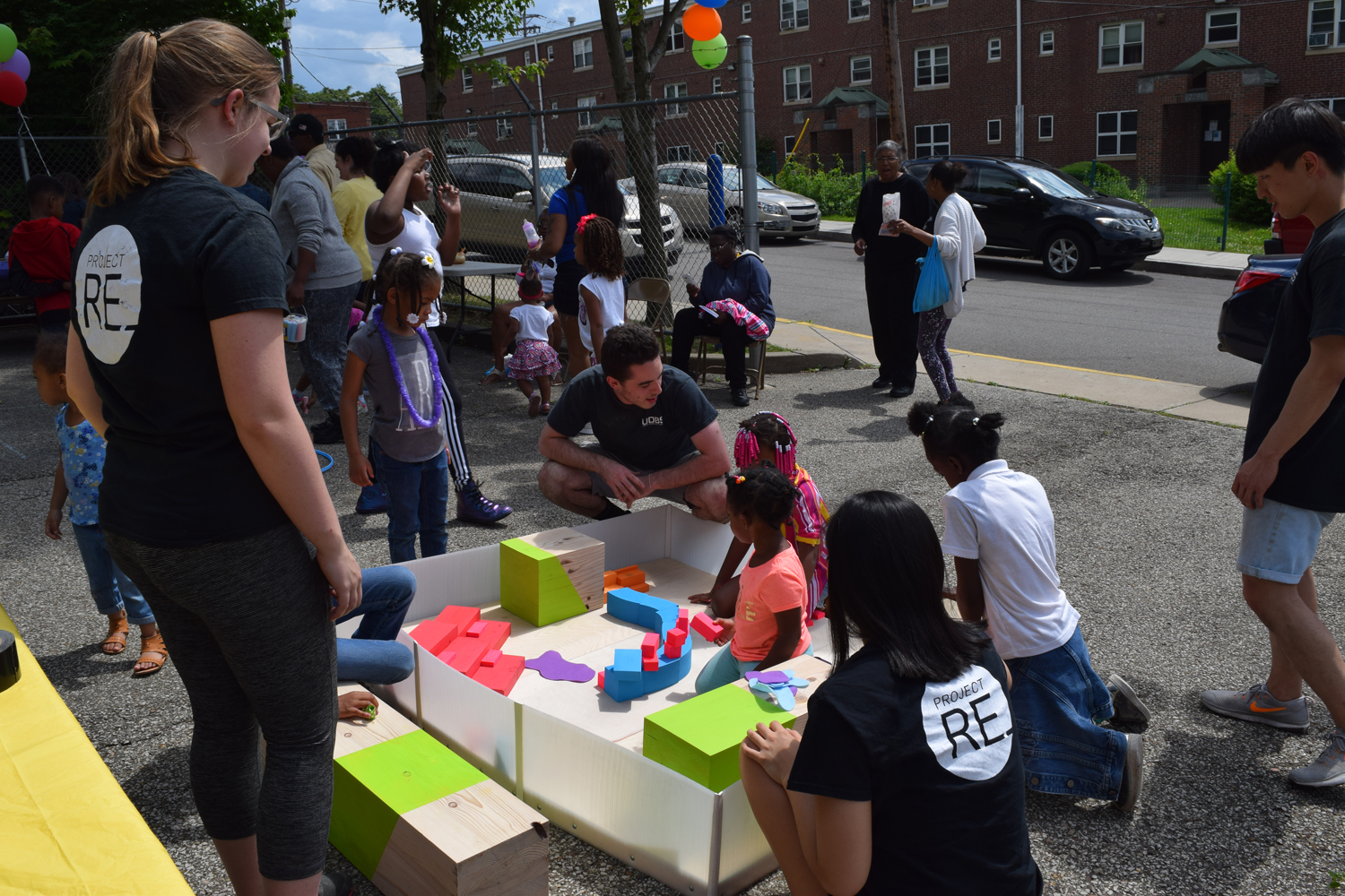 Photograph taken during the Bedford Connect event on June 9, 2017. The image shows children playing inside a block model developed by the studio intended to help facilitate discussion around programming and space-use for the Pop-Up.