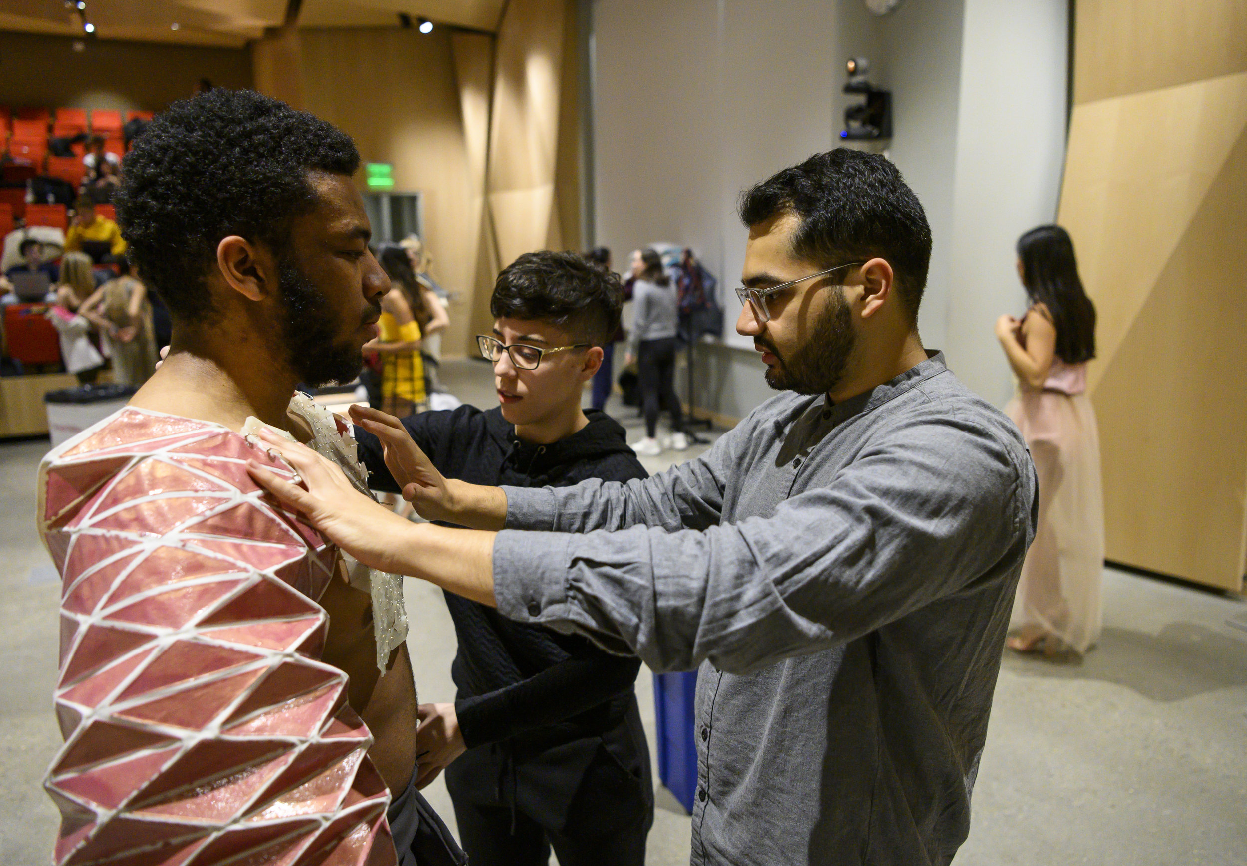 Zain Islam-Hashmi adjusts a top during a rehearsal for Lunar Gala, which will be at 8:00pm on Saturday 02 March at the Cohon University Center. Image Credit: Carnegie Mellon University