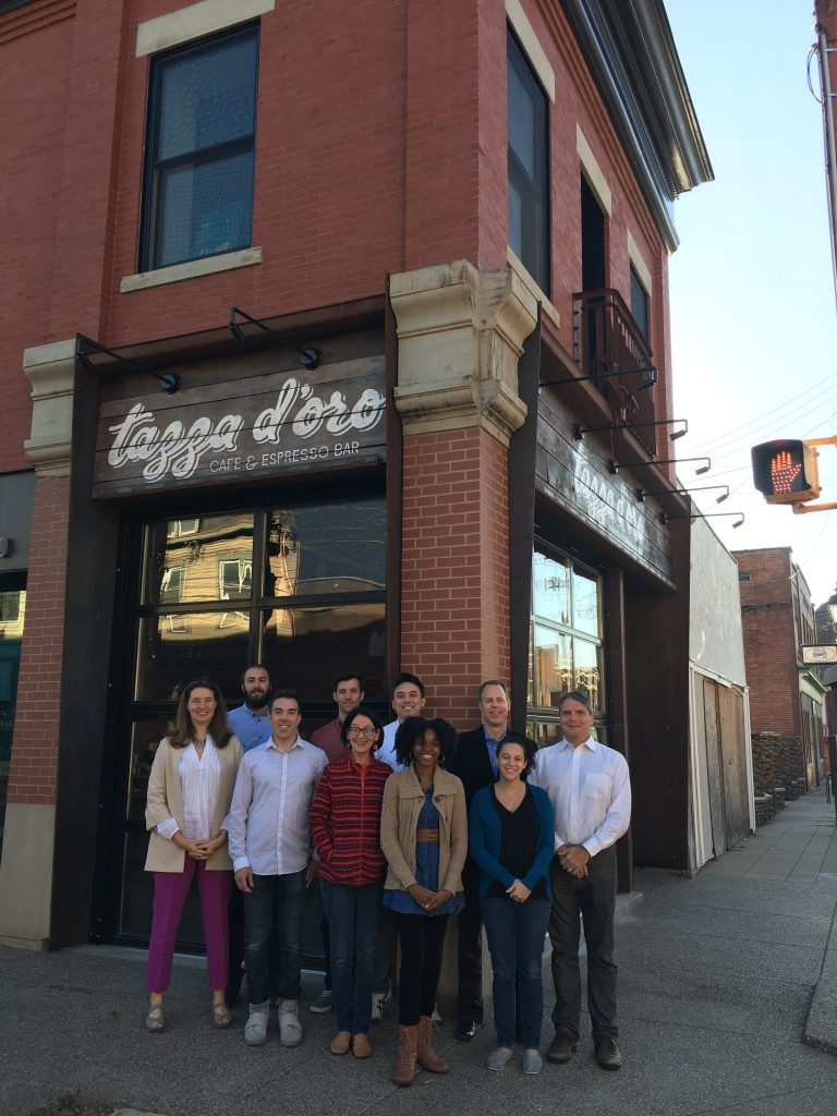 Christine Mondor, FAIA (left) and the evolveEA team in front of the building they designed for local coffee shop chain, Tazza d'Oro in Millvale, PA. Photo: evolveEA.