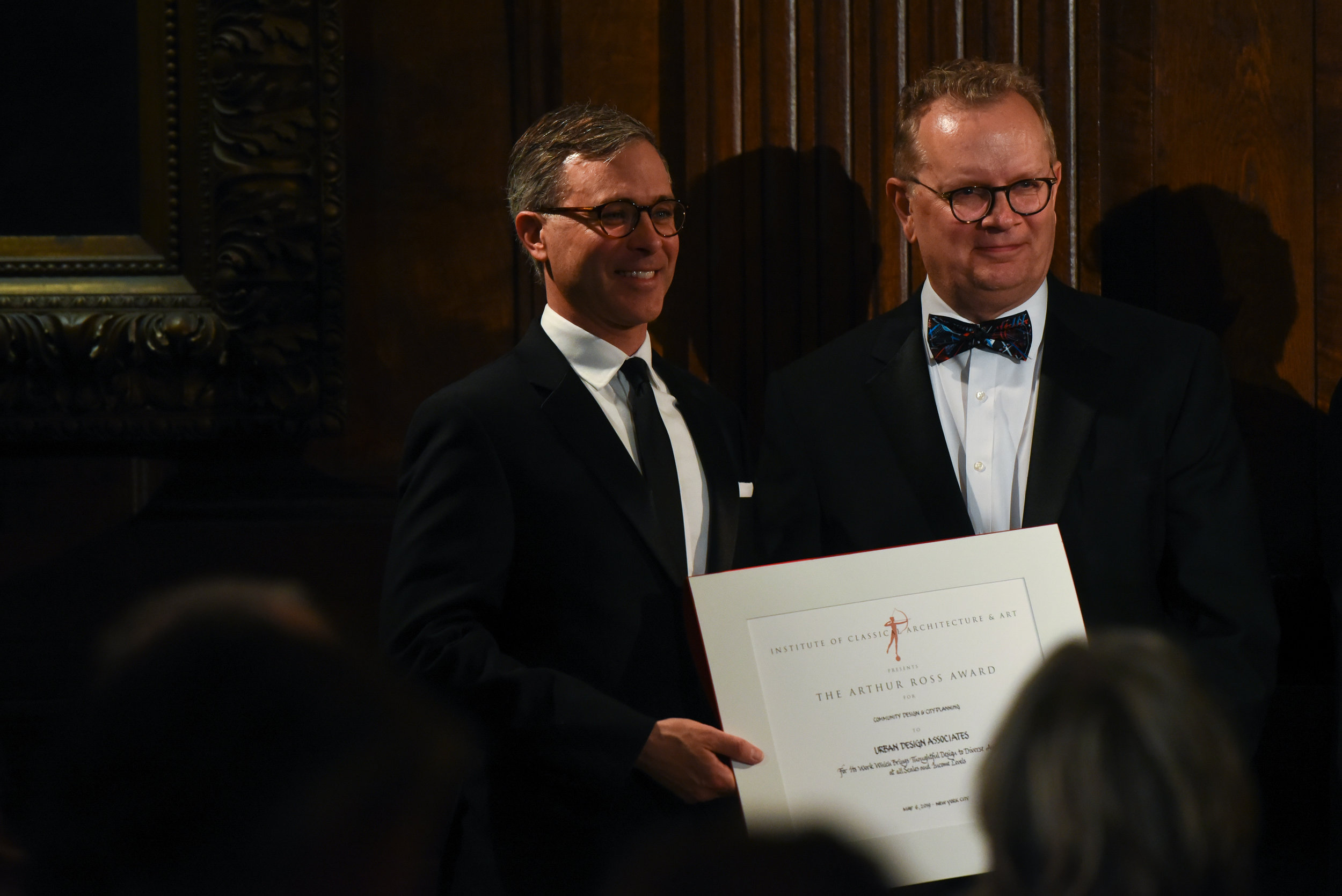 Paul Ostergaard (right) and fellow partner Eric Osth (left) accepted the 2019 Arthur Ross Award for Community Design, Civic Design, and City Planning on behalf of UDA. Photo by Jared Siskin/PMC