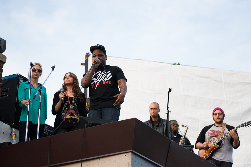 Jabee performing on top of Velvet Monkey Salon in our Style Matters tee.
