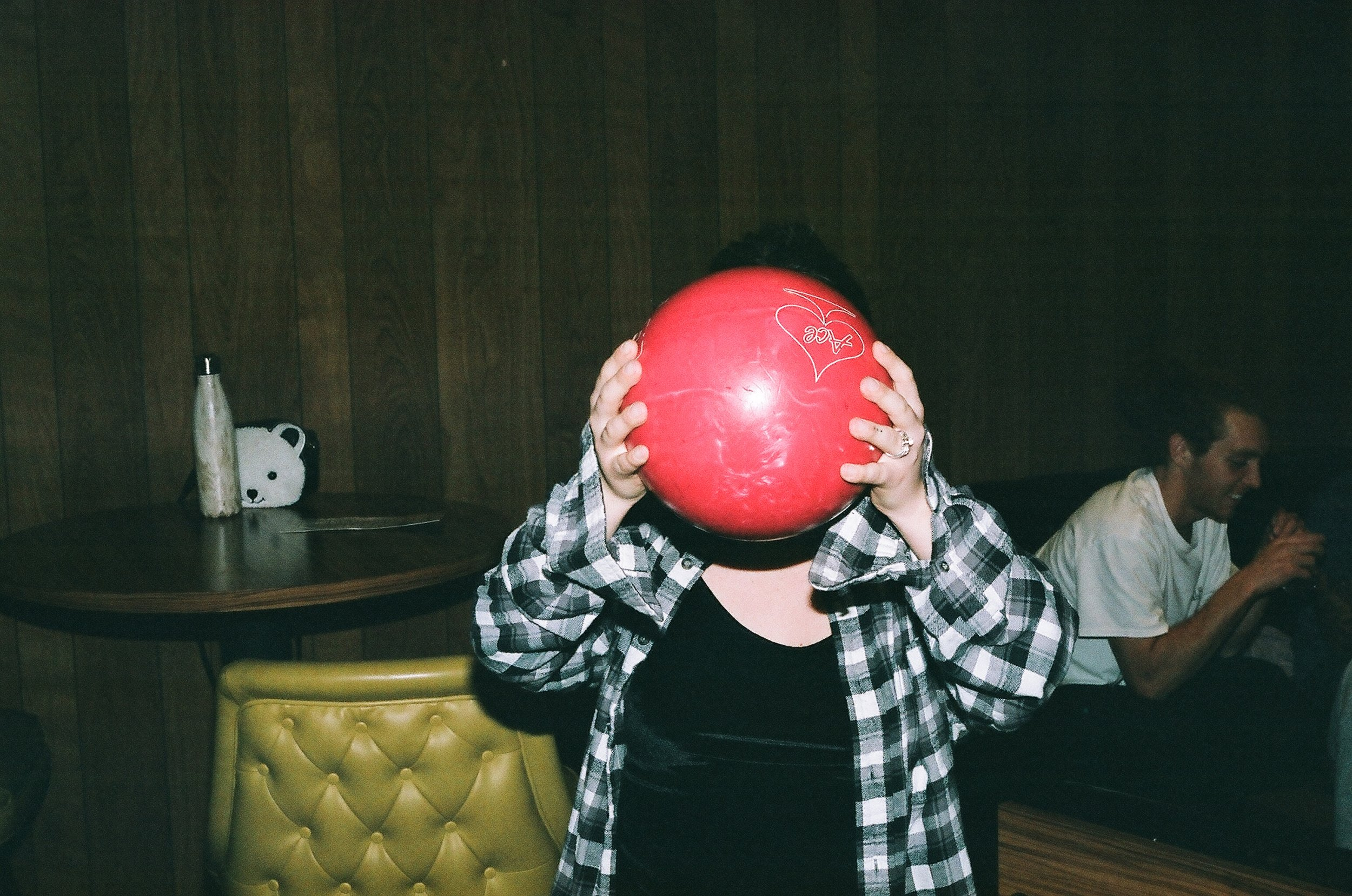 None of us were cool enough to bring a personal bowling ball, so we all played house ball.