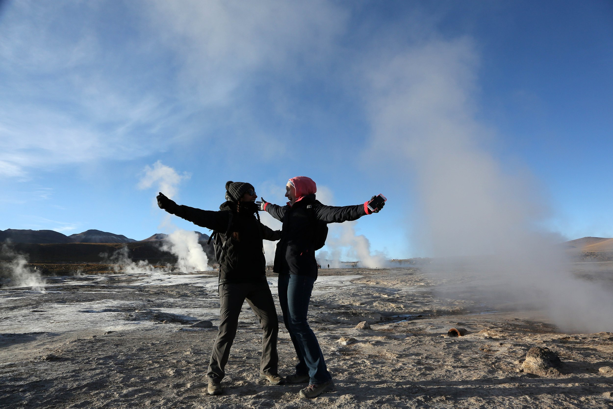 Admiring the erupting geysers, Chile