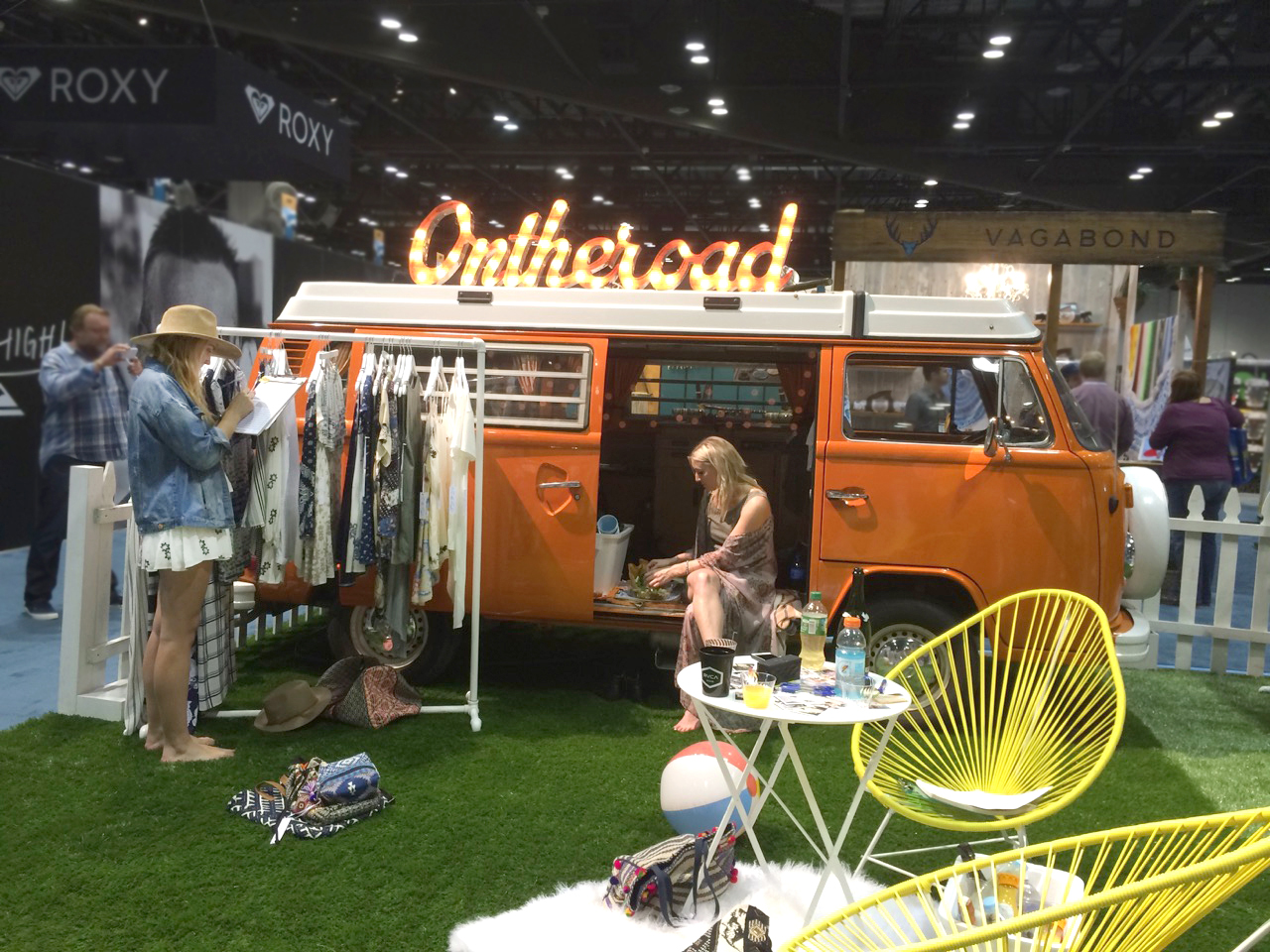 Metal signage and a fun little open booth space from OnTheRoad.