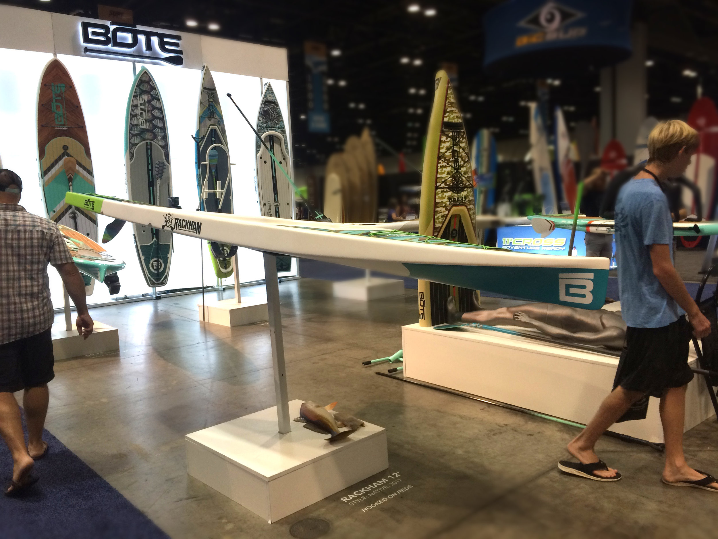 Bote flipped the standard SUP booth and mounted boards horizontally, chopped boards in half and even made a few into tables around the booth.
