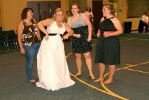 Brittany at a wedding — second from right