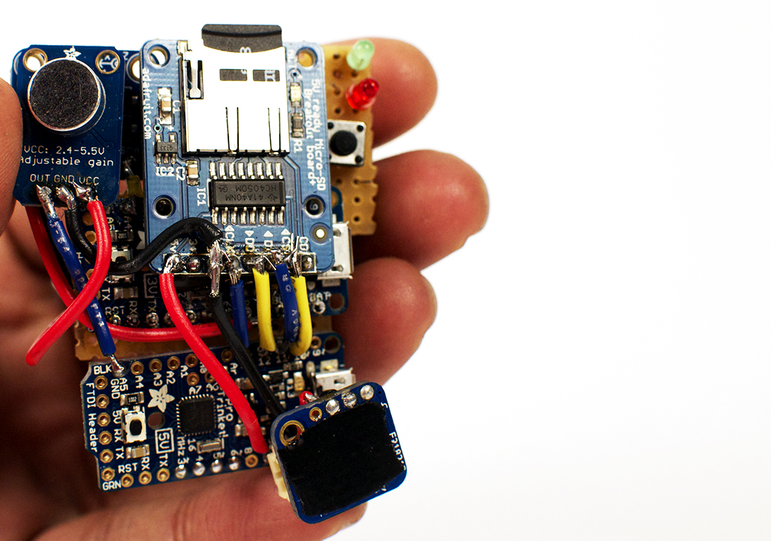 The final circuit for the Hands Up Audio Recorder. It is comprised of two Adafruit Pro Trinkets, a microphone amplifier, an SD card writer, and an accelerometer.