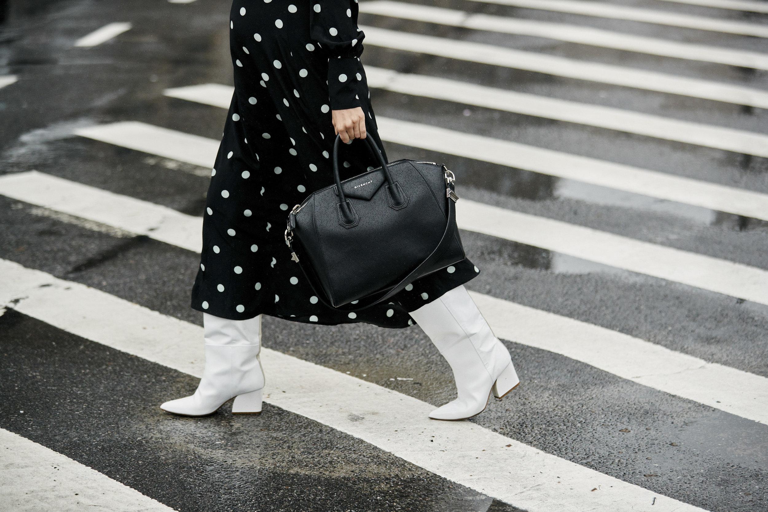 I'm wearing:   Zimmerman Dress ,  Tibi Boots , Givenchy Bag, Celine Sunglasses.
