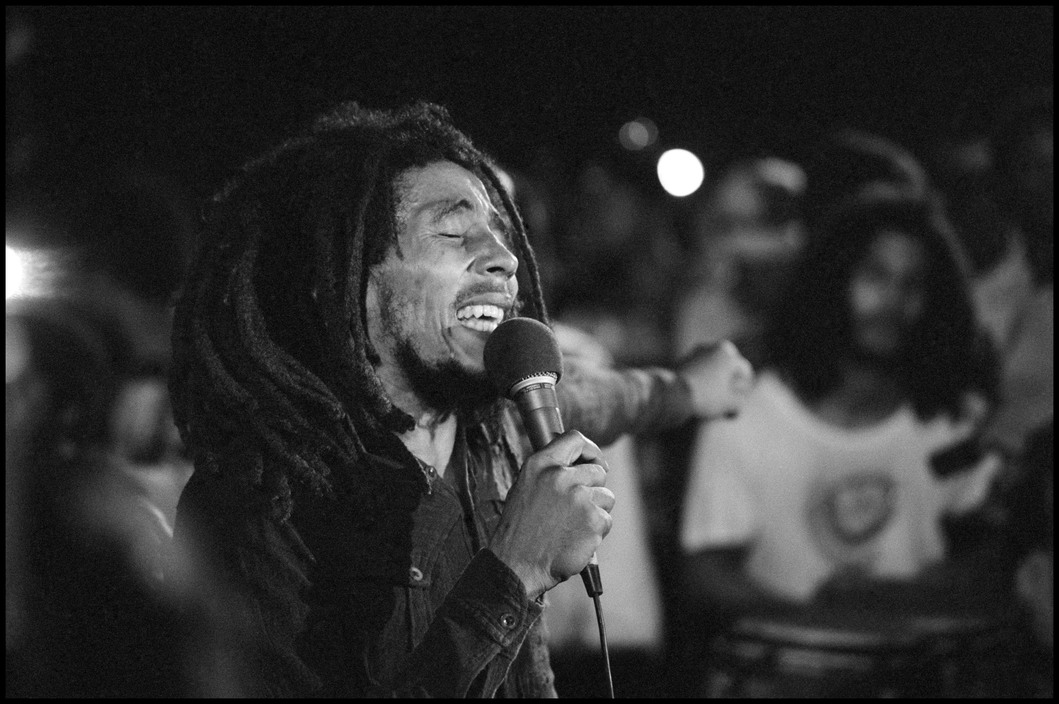 Bob Marley performs in Kingston, Jamaica, 48 hours after a failed assassination attempt, 1976. Photograph by Alex Webb.