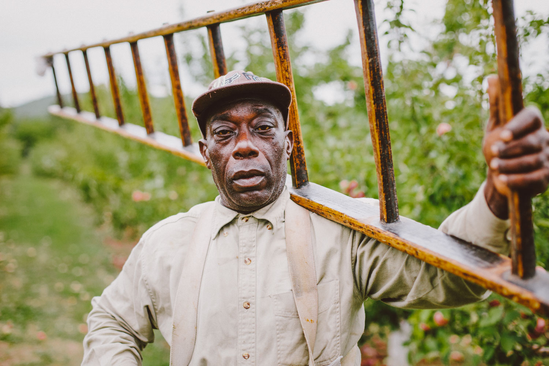 Portrait of commercial farm worker by Adam DeTour