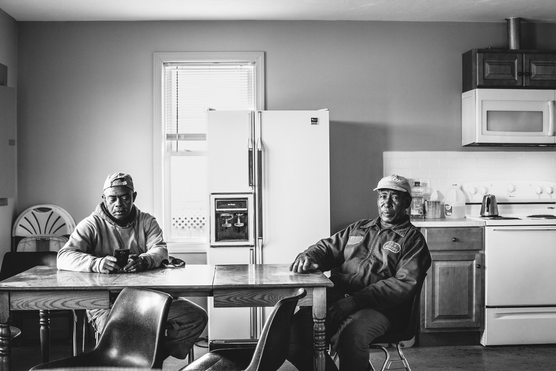 Portrait of workers on a commercial farm taking a break by editorial. Boston based photographer Adam DeTour.