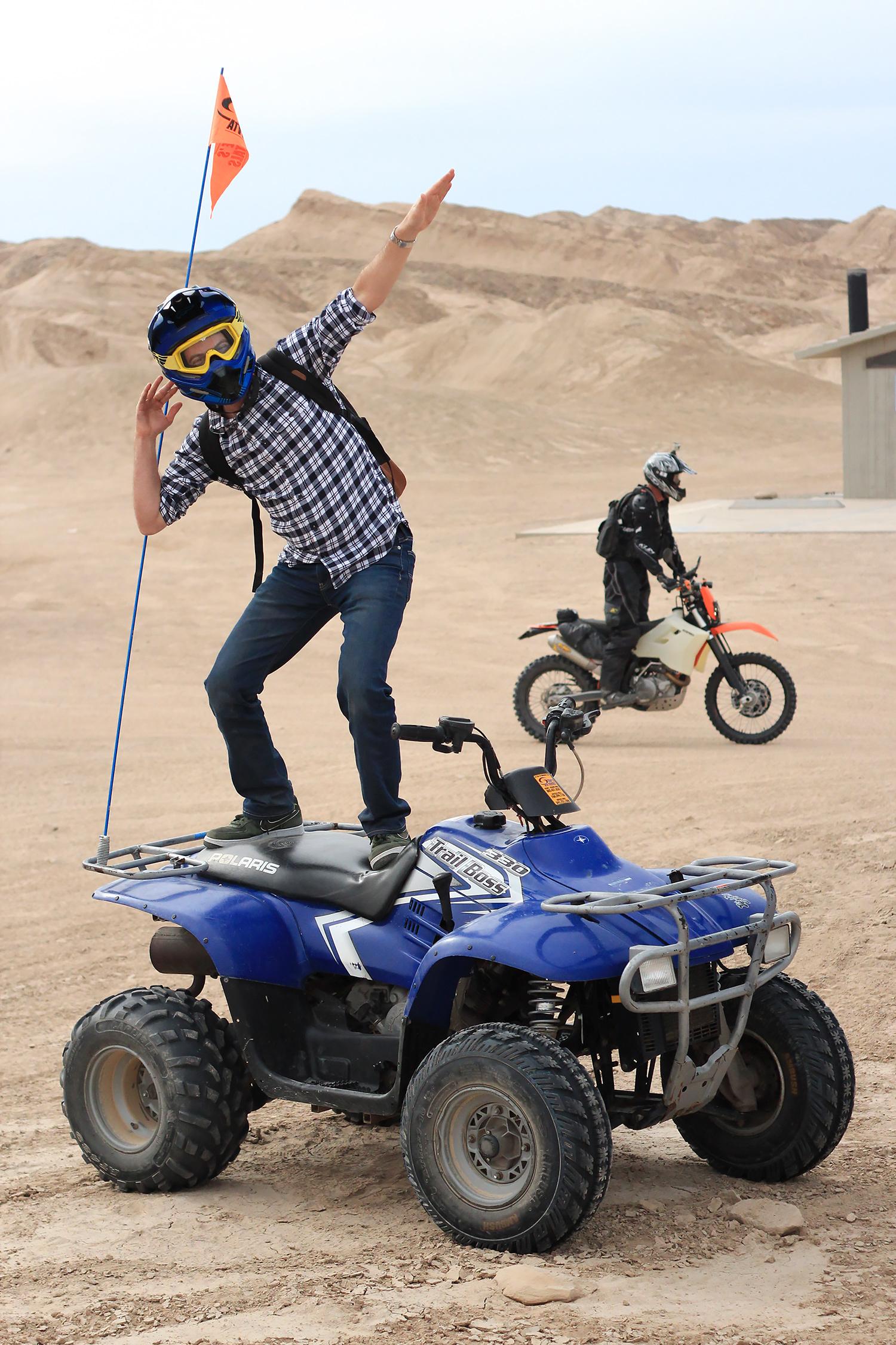 John striking a pose on the ATV