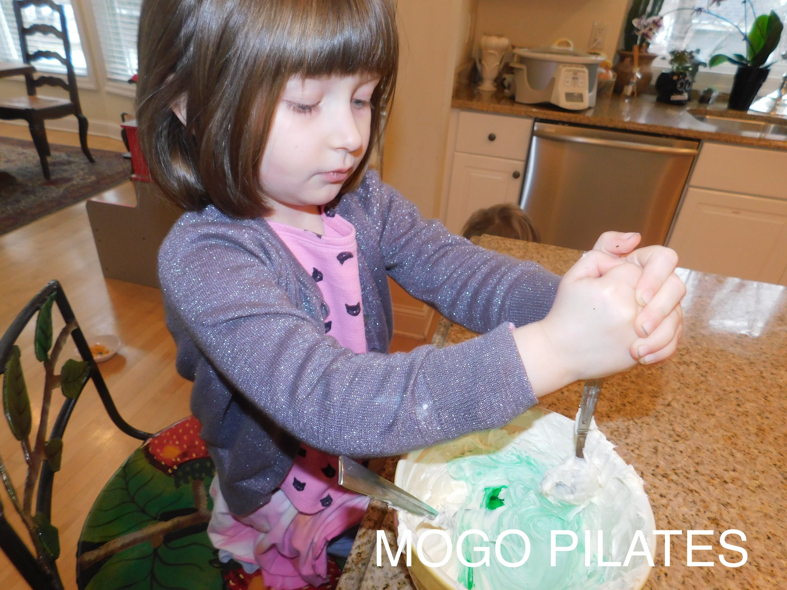 "Iris was in charge of making the icing ""magically"" turn green!"