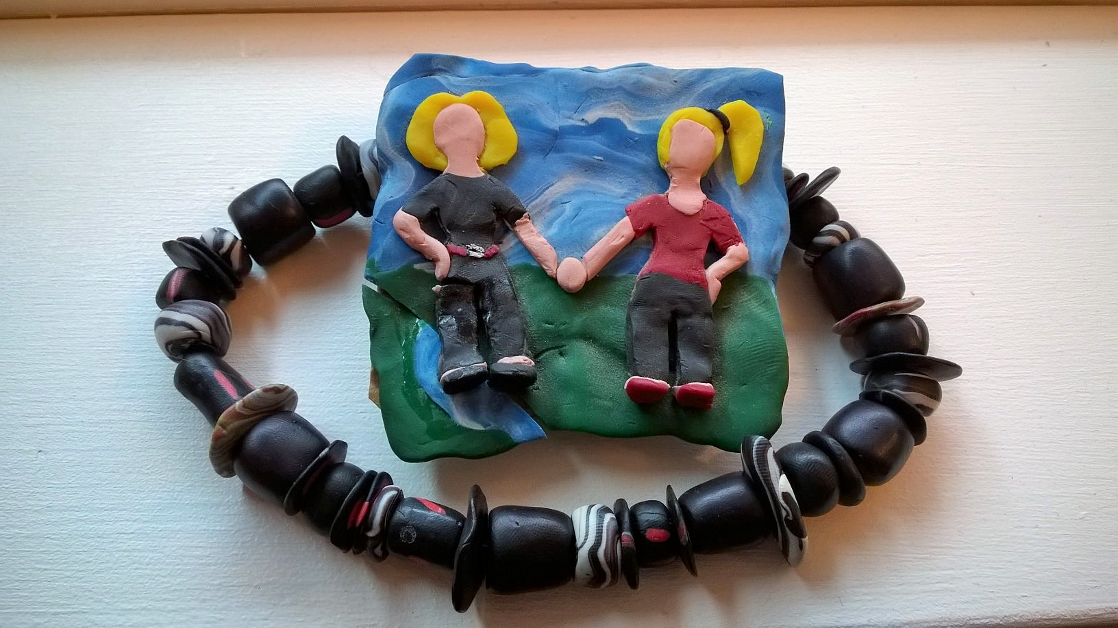Figure  9 : Age 18. Fimo necklace, and what my mom and I would've looked like as Claymation.