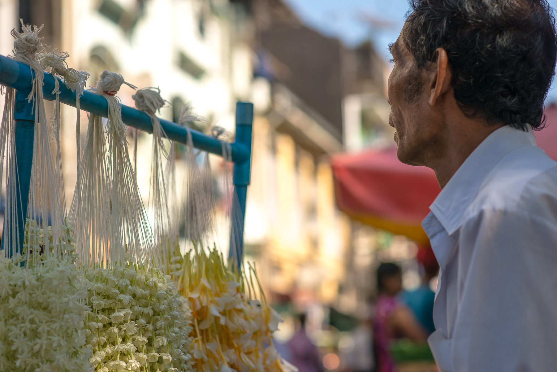 Flowers for sale for the offering to Buddha. Yangon, Myanmar