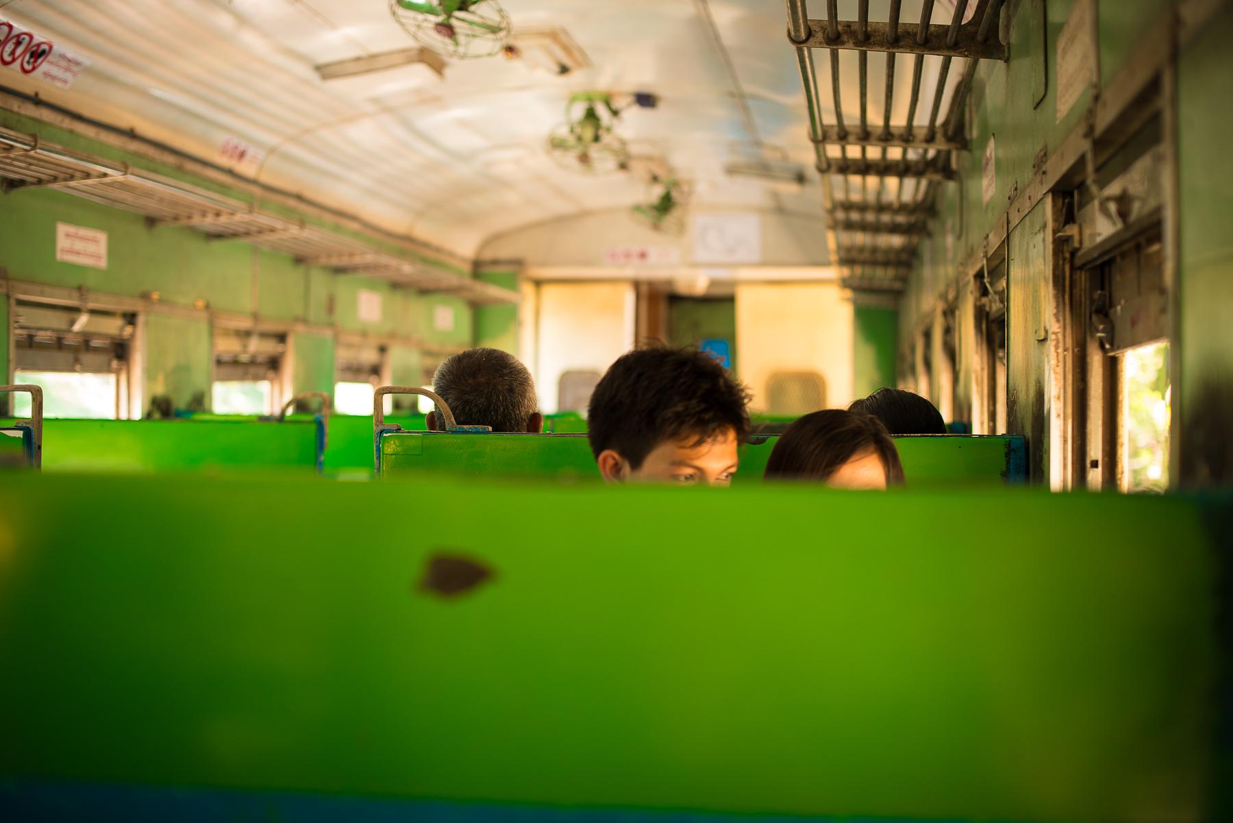 Couple on circle train. Yangon, Myanmar