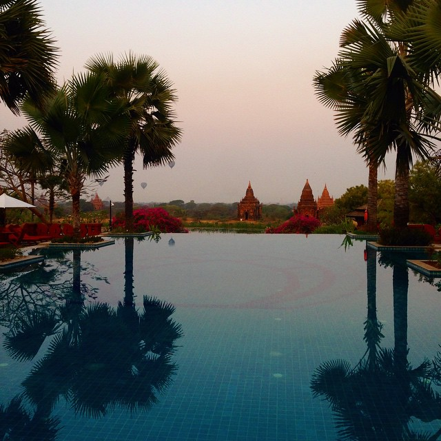 Hot air balloons over temples. Aureum Palace Hotel. Bagan, Myanmar