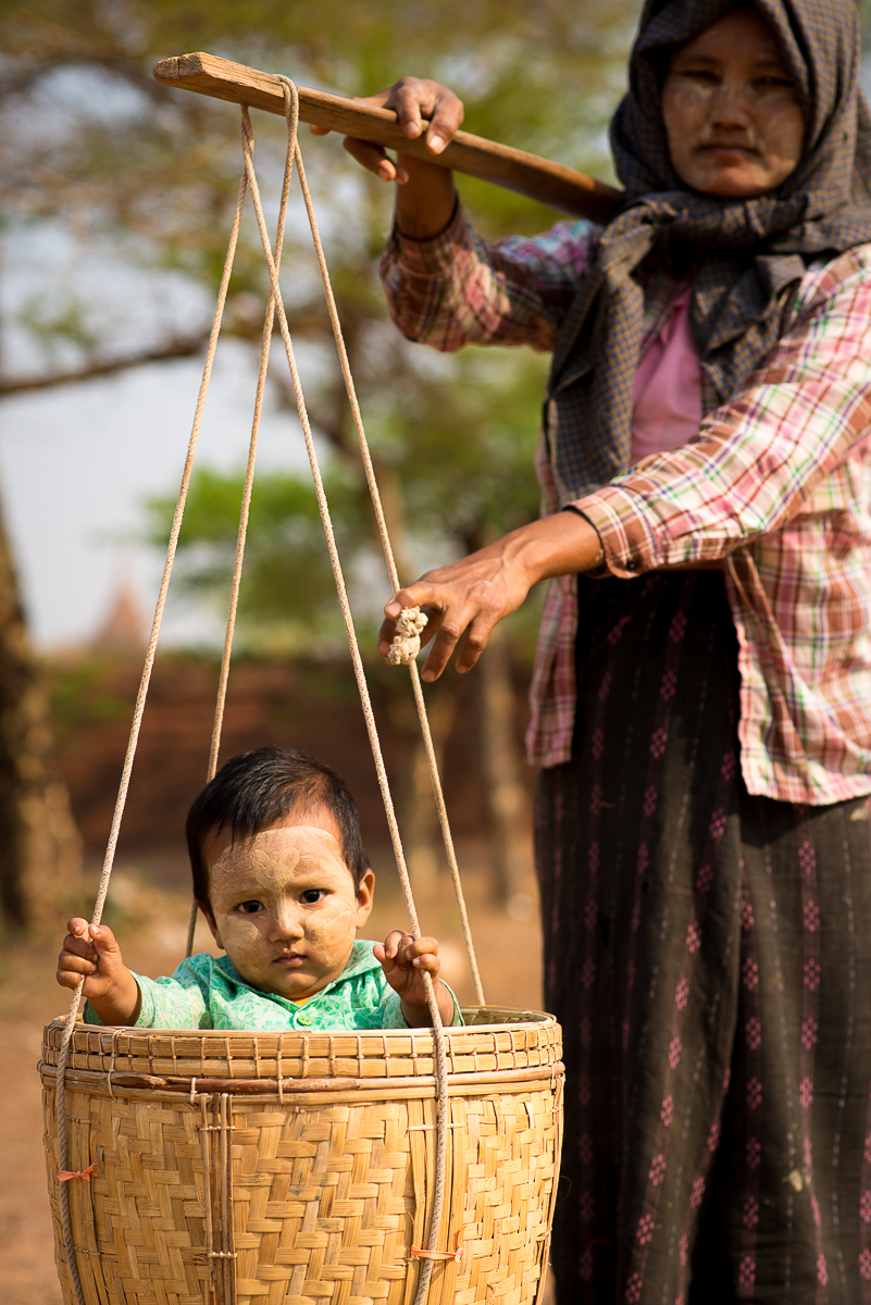 Local woman at a temple with baby. Bagan, Myanmar