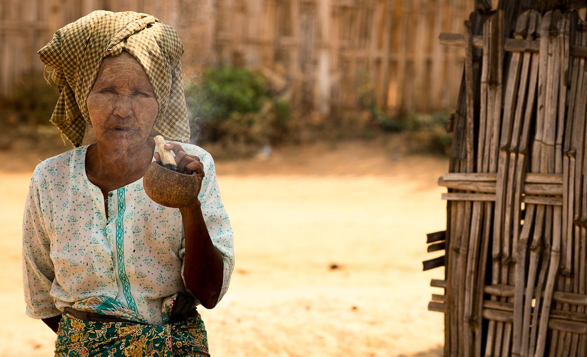 Old lady smoking a cigar. Bagan, Myanmar