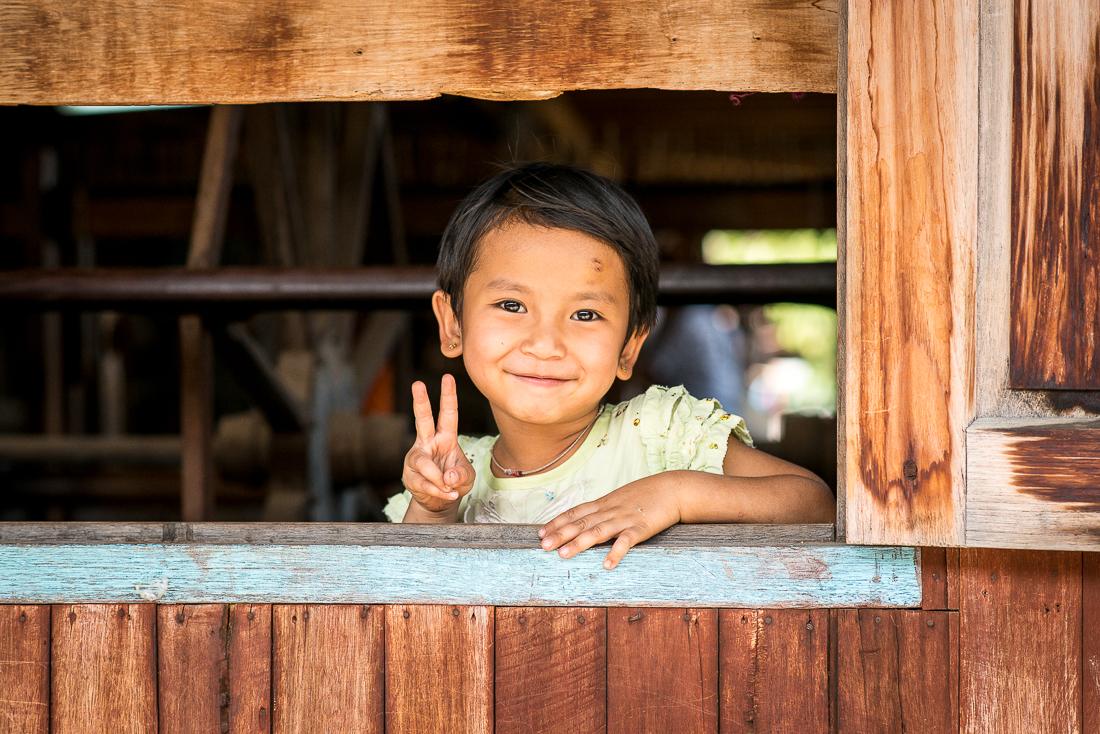 Village girl at weaving factory. Inle Lake, Myanmar