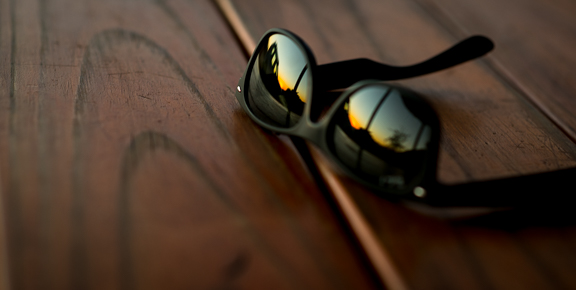 Sunset and my ride reflected in my sunglasses.