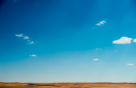 Red sand dunes in the distance. The desert road D707. So isolated.