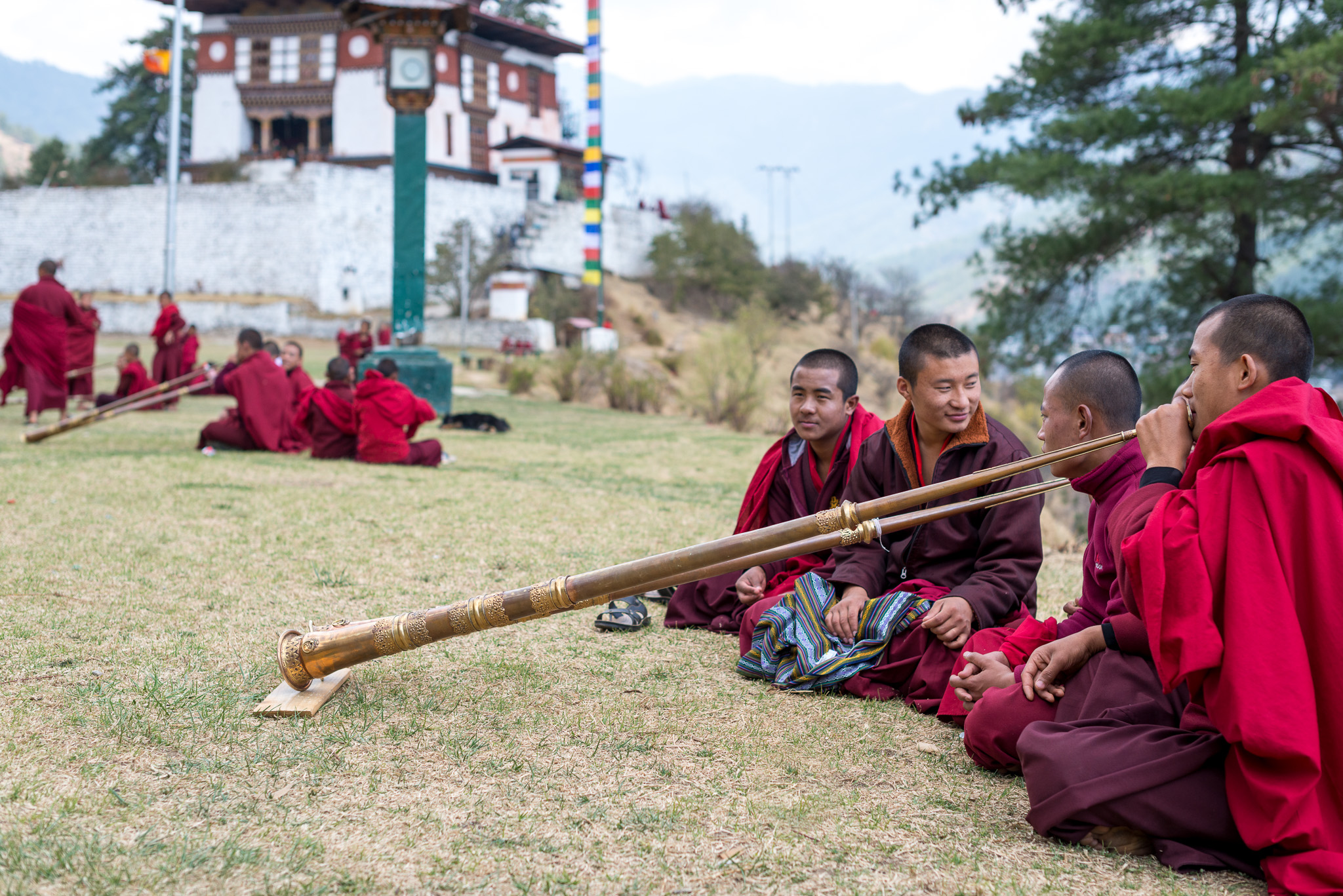 Monks practicing horns