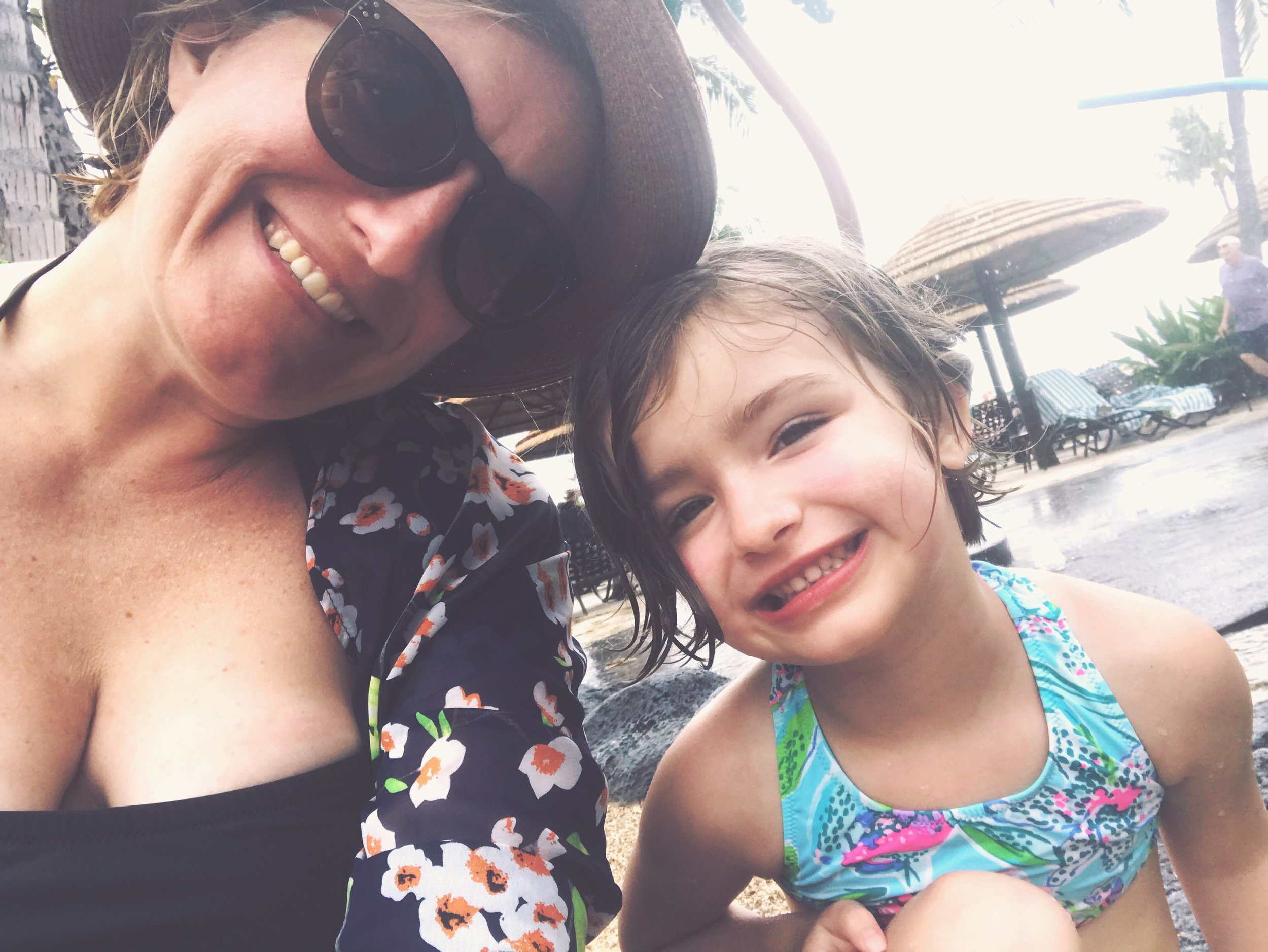 Little Miss and I, sitting by the pool.