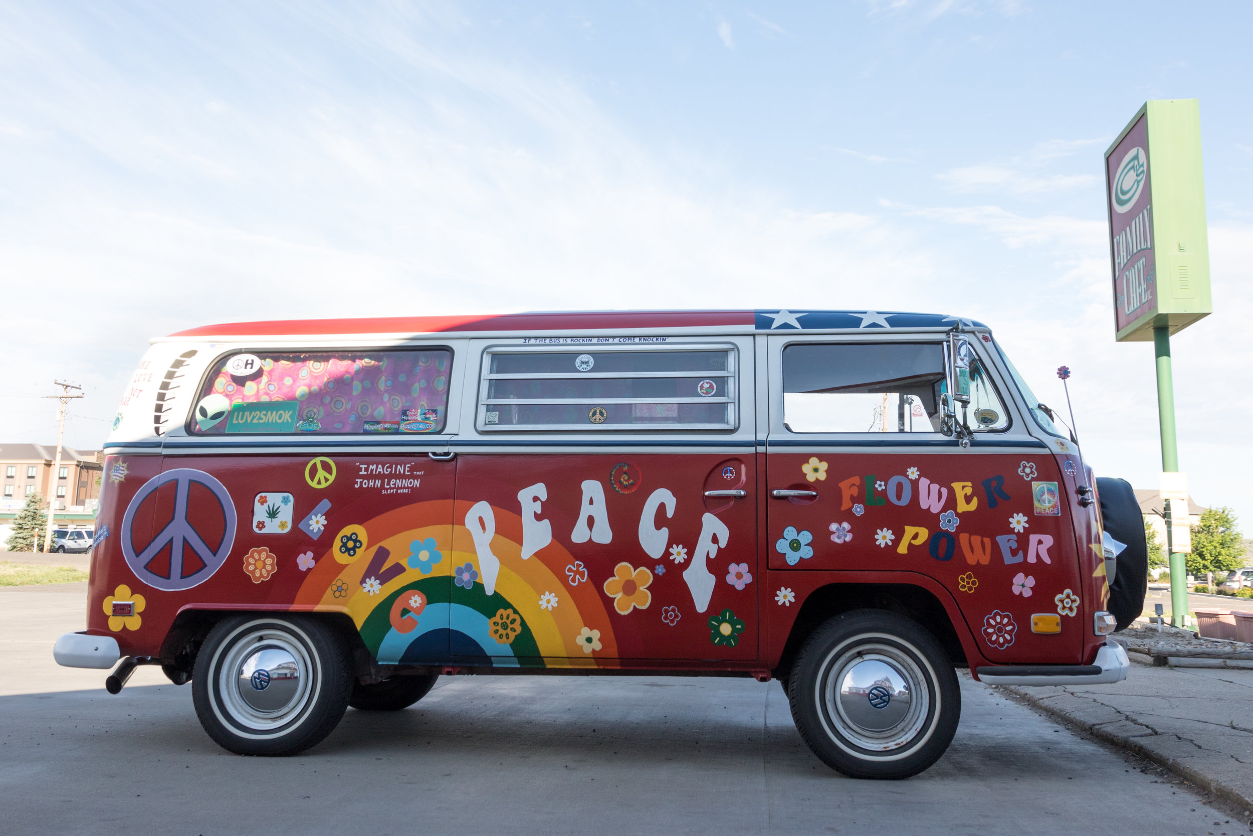 """The restored 1971 VW """"Hippie Bus,"""" parked in the lot of CC's Cafe in Glendive, Montana."""