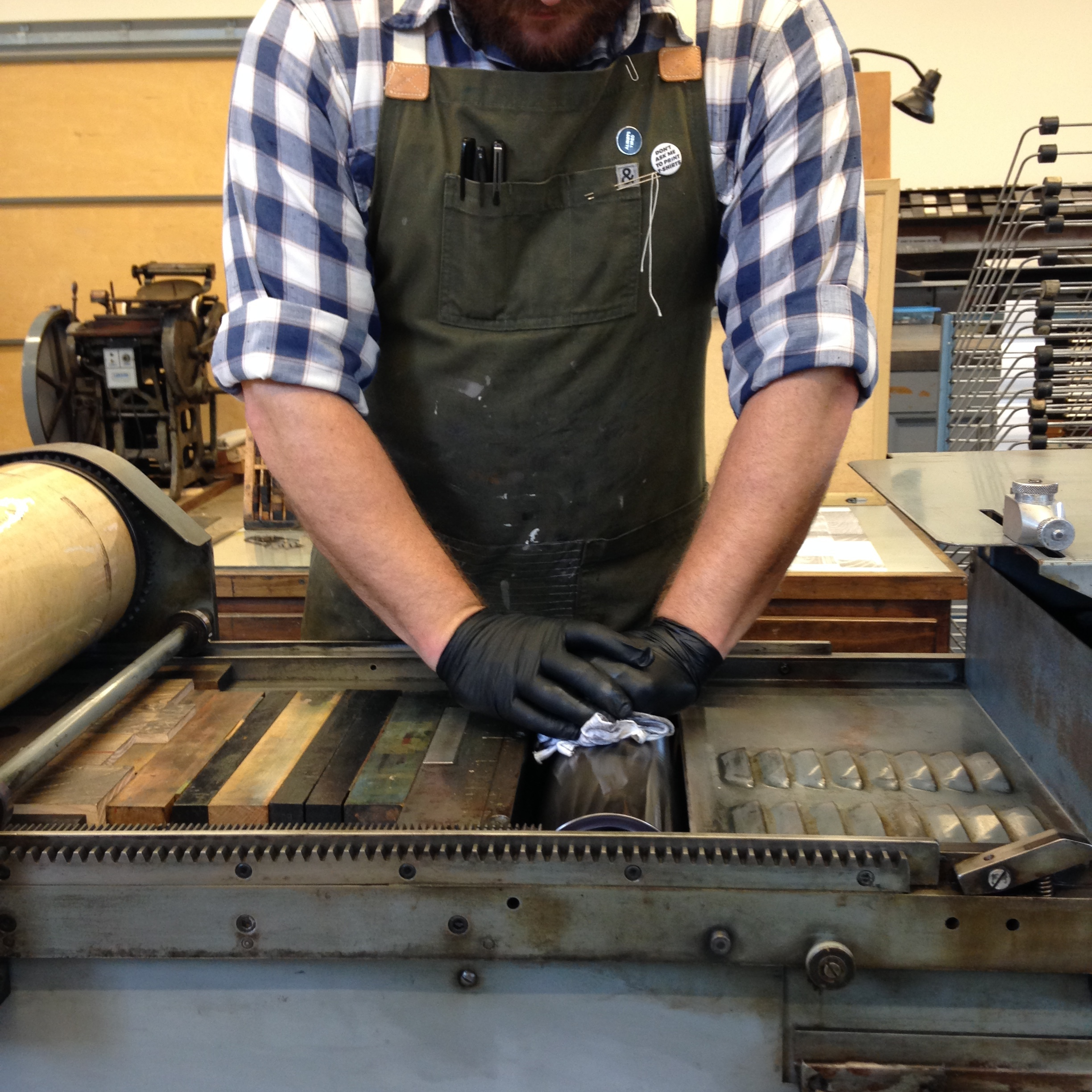 Penland's Print Studio Cordinator Jay Fox on press.
