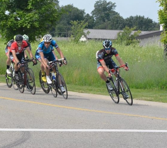 Pictured far right: Racing at the 2015 Miller Energy Criterium in Kalamazoo, MI for the Bissell-ABG Cycling Team.
