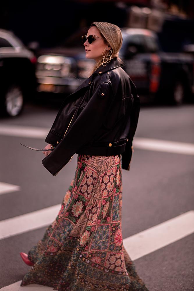 Christie Ferrari wearing Alice + Olivia two piece set with black leather jacket maxi skirt