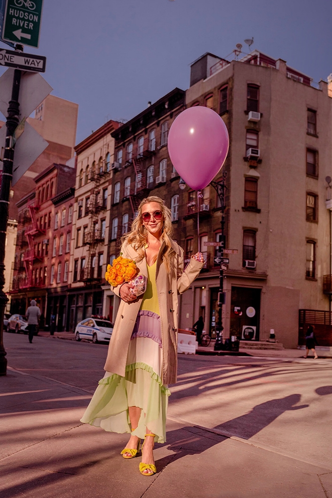 Christie Ferrari wearing Spring pastels with tiered colorful dress and chunky sandals