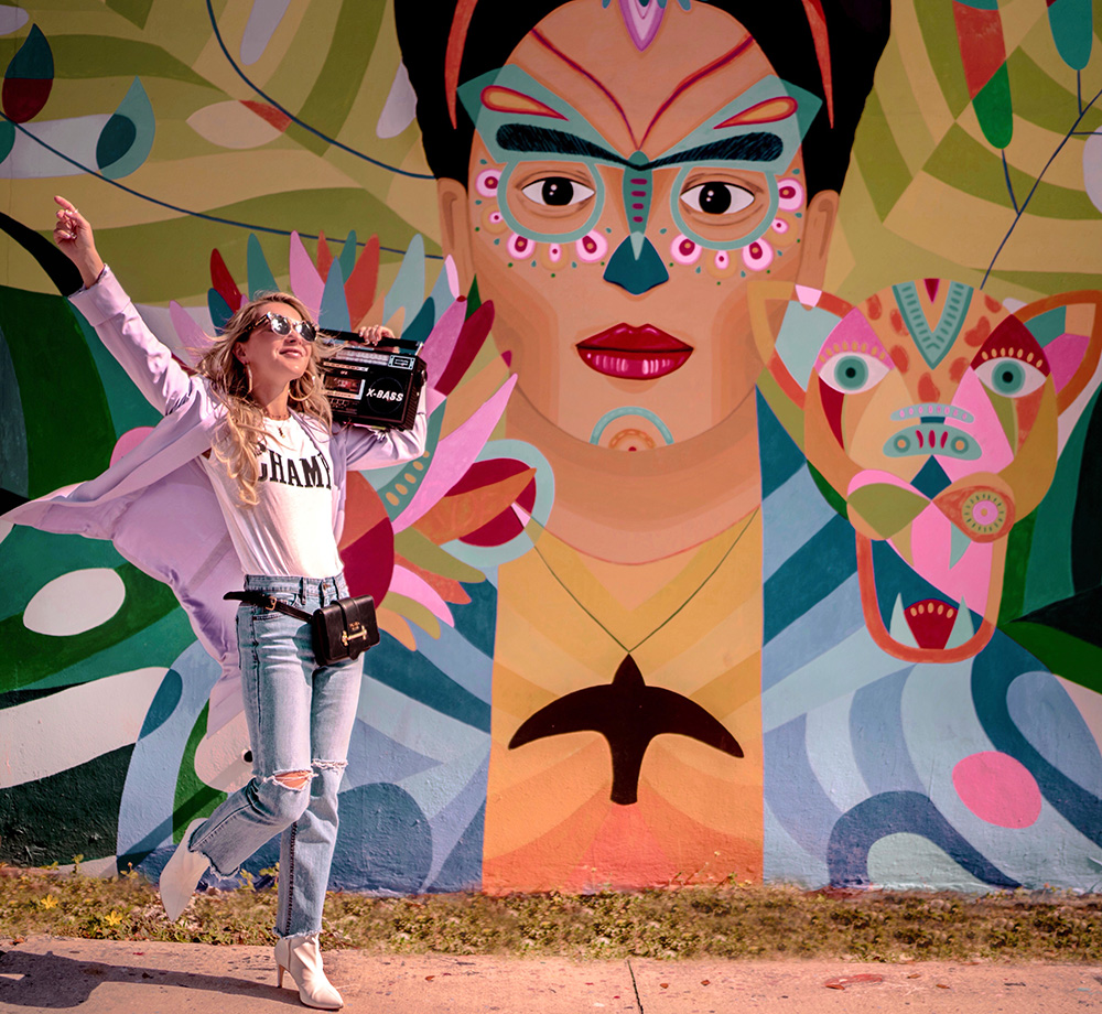 Christie ferrari in Wynwood, miami, wearing lavender blazer from alice + olivia, ,jeans and tee.