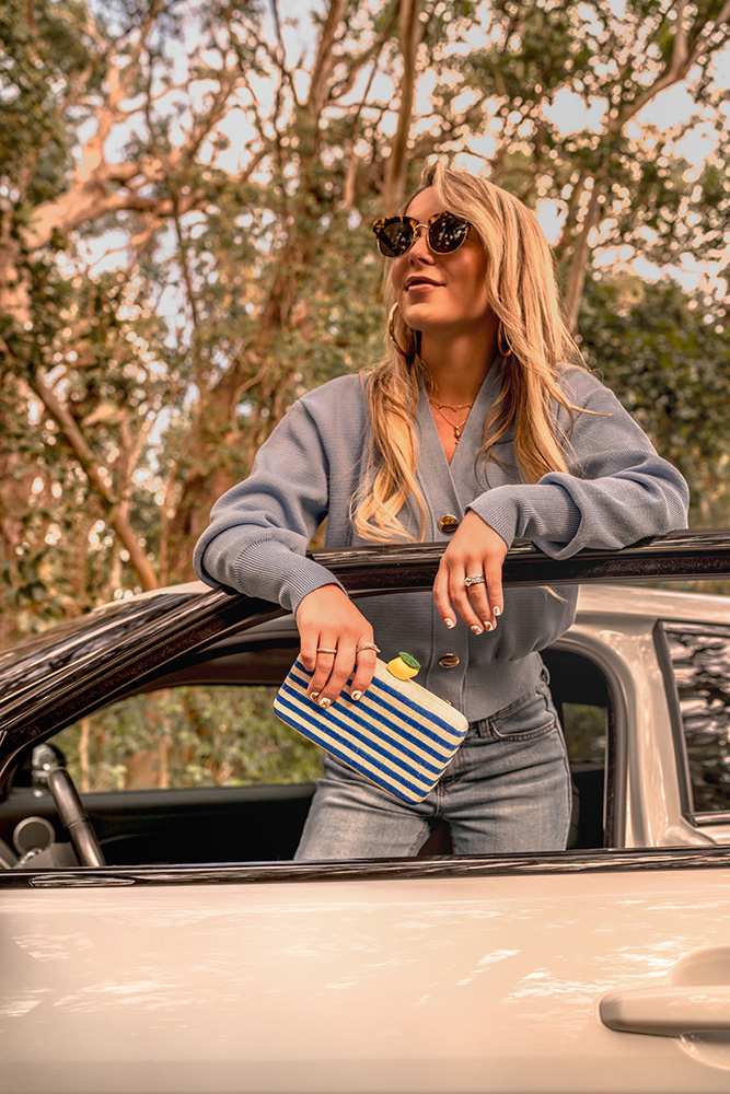 Christie Ferrari with the Kayu Vera clutch summer 2018