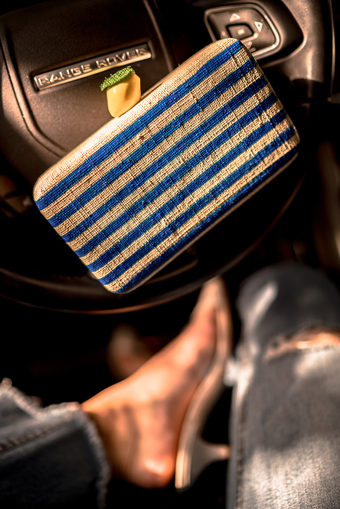 Christie Ferrari wears Kayu Vera Clutch for Hot bag Alert series on Summer clutches for 2018.
