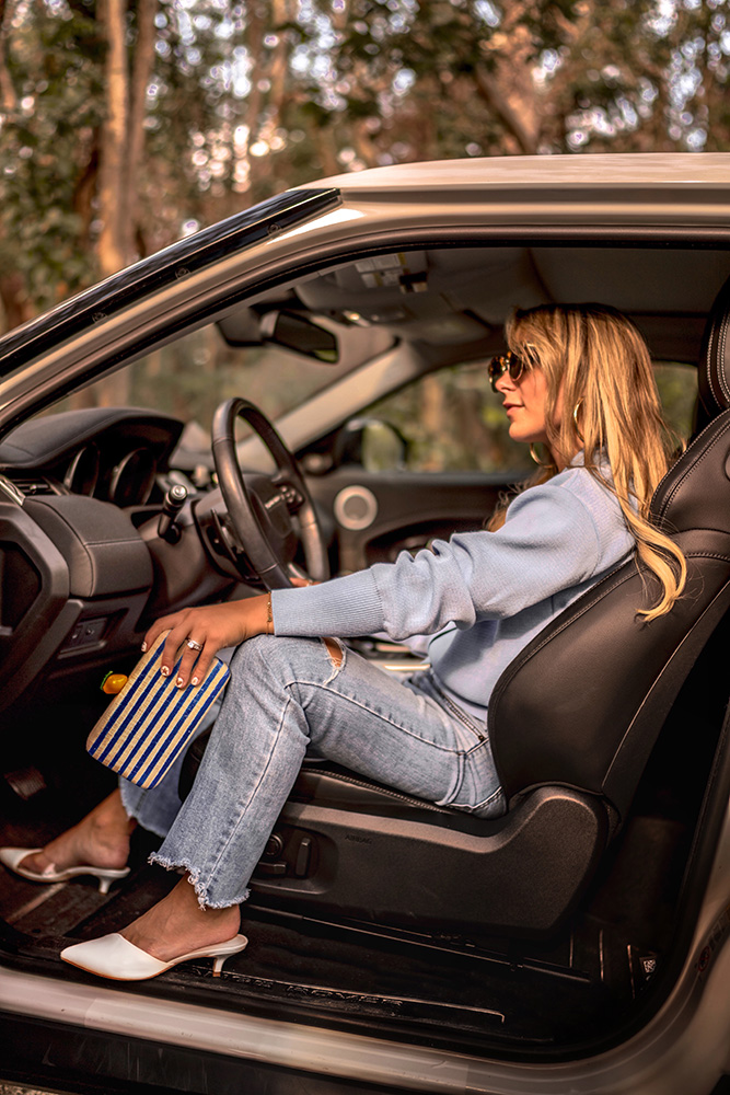 Christie Ferrari drives with her Kayu Vera Summer Clutch for 2018 summer. Hot bag alert and review.