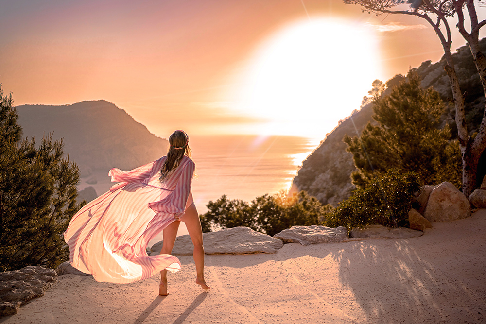 Christie wears Alexandra Miro pink candy kimono in Ibiza for Cover Up Summer 2018 round up.