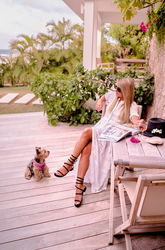 Christie Ferrari wears coil ankle strap sandals from DSW in St Barths for Hot Shoe Alert Feature in July 2018.