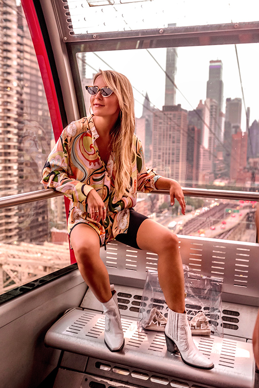 Christie Ferrari wears biker shorts for special fall trend coverage with tunic in New York City.