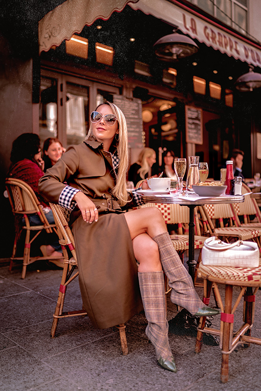 Christie Ferrari wears Tara Jarmon trench coat for Fall, in Paris.