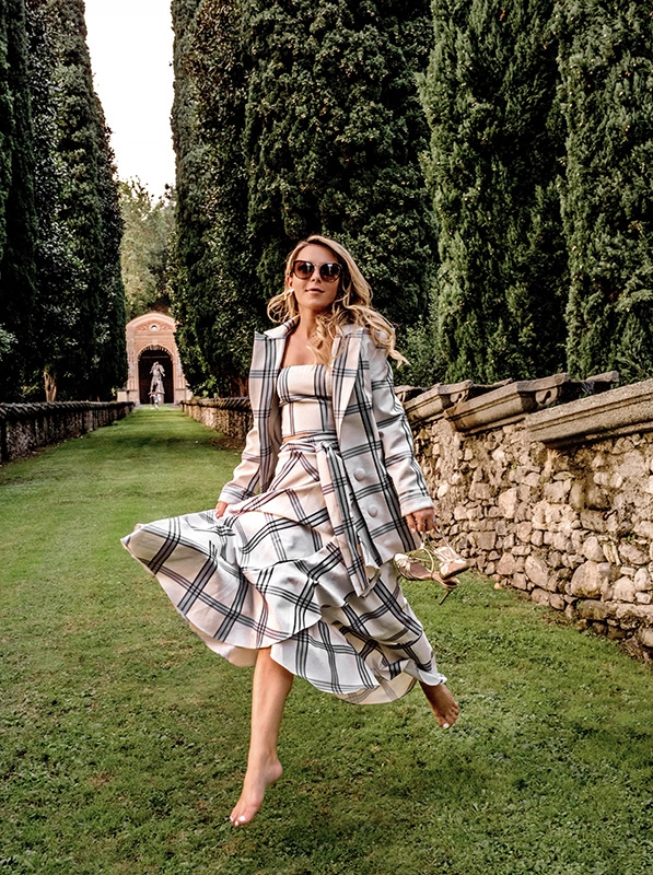Christie Ferrari wears Iorane skirt suit in Italy. Shop some of her favorite suits, including navy, black, sleeveless, corduroy and plaid.