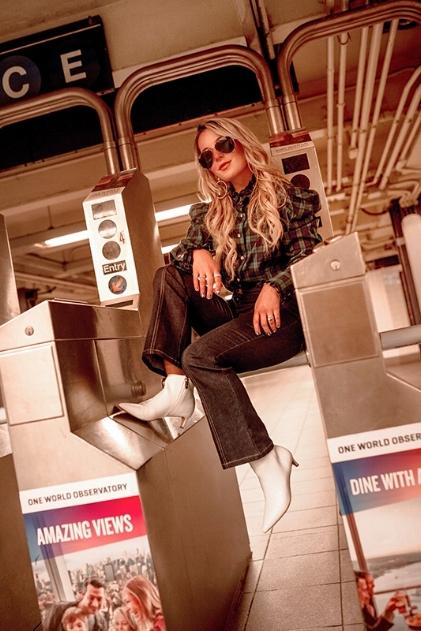 christie ferrari wears 2018 shoe trend white boots for hot shoe trend alert in new york city.